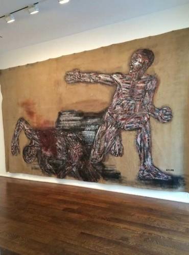 Installation view: Leon Golub, Napalm I, 1969, acrylic on linen, 117 1/4 x 213 i