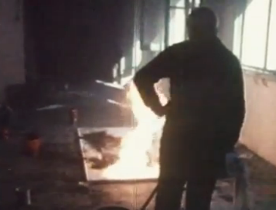 Joan Miró creating one of his Burnt Canvases (video screen capture - Joan Miró: