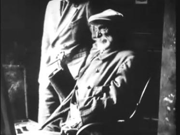 Video screen capture of Pierre-Auguste Renoir painting in his studio in 1915