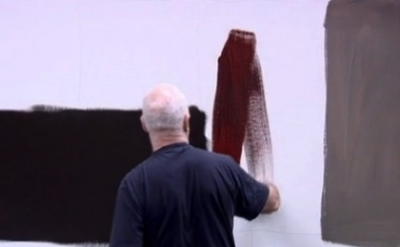 Sean Scully painting in his studio (video capture from Sean Scully: The Bloody C