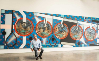 Studio view: Lari Pittman in front of his painting: Flying Carpet With Waning Mo