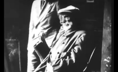 Video screen capture of Pierre-Auguste Renoir painting in his studio in 1915