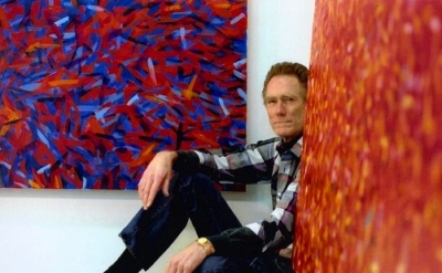 John McCracken with paintings