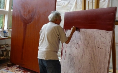 Nathan Oliveira painting in his studio